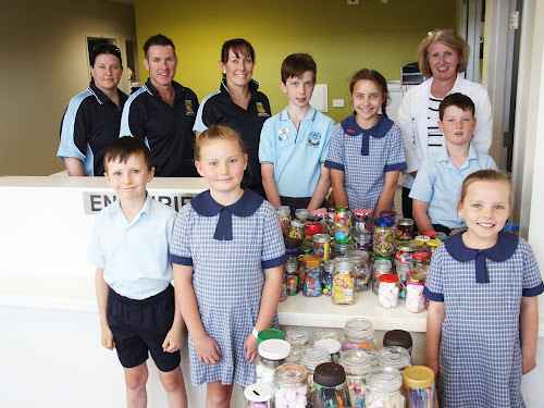 Getting ready for Saturday's Narrabri Public School fete, along with some of the items for the traditional bottle stall are, back, P and C committee members Courtney Burke, secretary Rob Smith and vice president Donna Bower, students John Allison, 12, Lily-Rose Baker, 12  and Noah Allen, 8, in front of principal Marion Tame, front, students Jad Harris, 8, Chelsea Stait, 8, and Sophie Chisholm, 7.