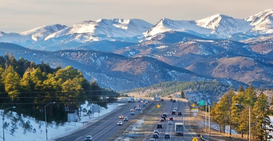 cars driving on a freeway toward the mountains in Colorado