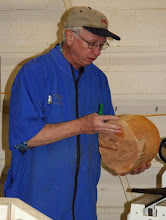"Photo: For his demo, Ron began with a beech round about 12"" in diameter. After some comments about design and shapes, he got to work with his Ellsworth bowl gouge with its long, swept-back wings..."