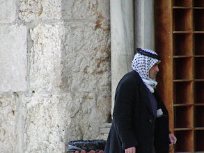 Photo: The head garb colors distinguish the person's origin.  The black-and-white keffiyeh is associated with the Palestinians.