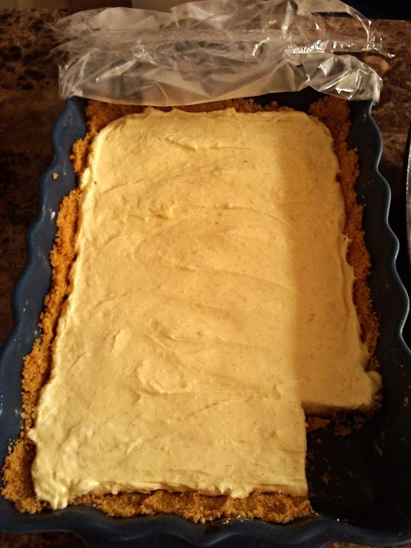 Scoop cheese into baking pan.  Spread it out evenly.  Cover with plastic...