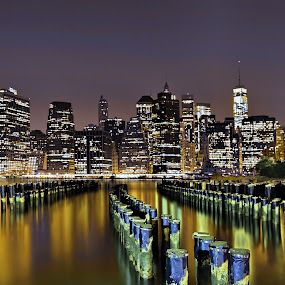 The Sticks of Brooklyn by Mike Lennett - Buildings & Architecture Other Exteriors ( water, skyline, light painting, east river, manhattan, long exposure, night, mike lennett, new york, pylons, brooklyn )
