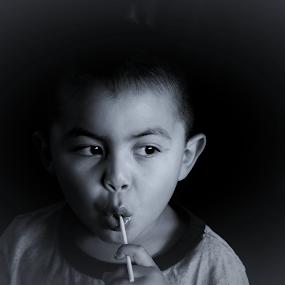 Enjoying a lolipop by Maria Epperhart - Babies & Children Children Candids ( grandson, kid, lollipop, black and white, portrait, boy,  )