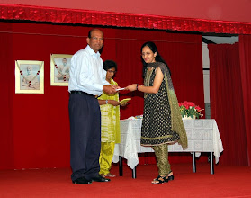 Photo: Mrs Meena receiving a token of appreciation for TAPAS Reading Program