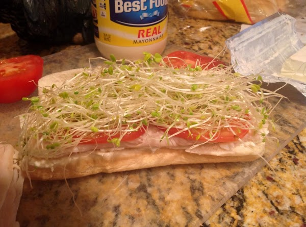Take a handful of bean sprouts and place on tomatoes.