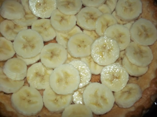 Bake pie curst to a golden brown. Slice bananas & place into curst.
