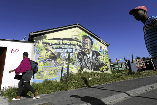 An image of former PAC leader and intellectual Robert Sobukwe looms large in the street artwork in Langa township, Cape Town. /Adrian de Kock