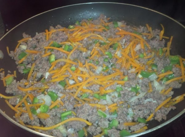 Once beef has been browned, to the skillet add; the diced onions, green peppers,...