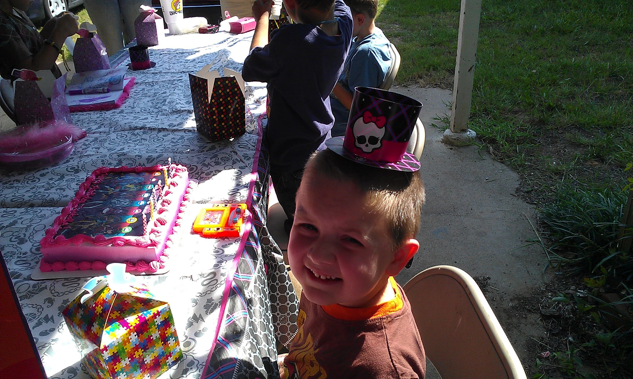 Photo: Saturday morning, The Boy and I had a birthday party to attend. The theme of the party was Monster High and I had never heard of it before. He thought the party hats were fun.