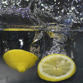 I take life with a twist of lemon, a shot of tequila and a pinch of salt. by Frøydis Folgerø - Food & Drink Fruits & Vegetables ( water, fruit, macro, drops, lemon )
