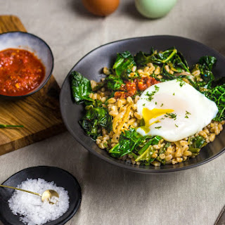 Stir-Fried Farro With Garlicky Kale and Poached Egg.