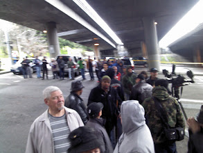 Photo: Half an hour later, the line was much bigger and the local media was interviewing people in line.