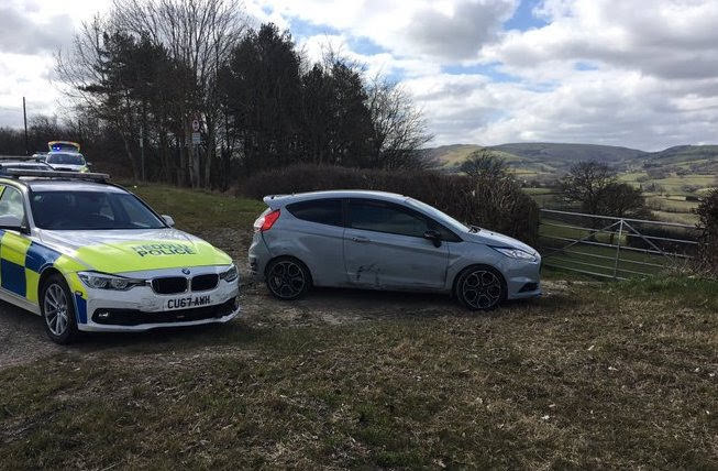 Two arrested after speeding off and throwing drugs from car