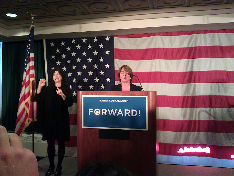 Photo: Senator Klobuchar speaks, and Dawn interprets.