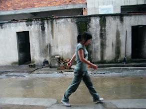 Photo: neighbor girl in walk in rain.