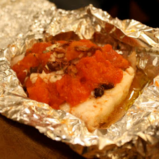 Red Snapper with Tomatoes and Olives Baked in Foil.