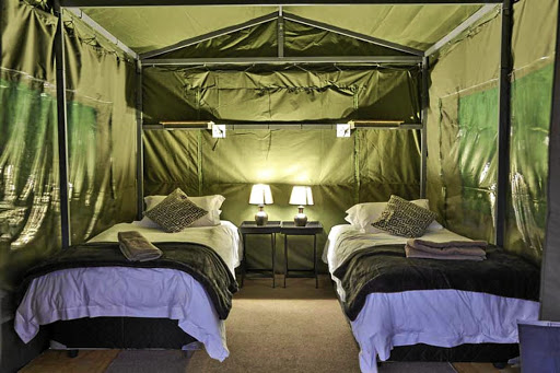 The interior of the tent offers an almost five-star experience in the bush.