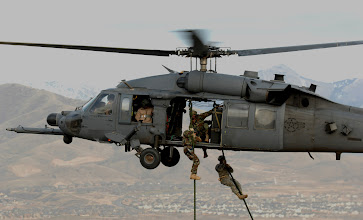Photo: Army personnel from the Utah National Guard, 19th Special Forces unit are lifted on board an Air Force HH-60 Pave Hawk helicopter over the Utah Test and Training Range on Nov. 9, 2007 during a Combat Search and Rescue (CSAR) Integration Exercise held May 6-15 in Utah. The 34th Weapons Squadron, United States Air Force Weapons School, Nellis Air Force Base, Nev. led the search and recovery training. The objective of the exercise was to expand expertise and integration with UtahÕs 211th Aviation Group AH-64 Apache Joint Rotary Wing, 4th Fighter Squadron F-16 Fighting Falcon Striker assets, 19th Special Operations Forces, and conduct extensive joint CSAR operations against surface to air threats.(U.S. Air Force photo by: Master Sgt. Kevin J. Gruenwald) released̟