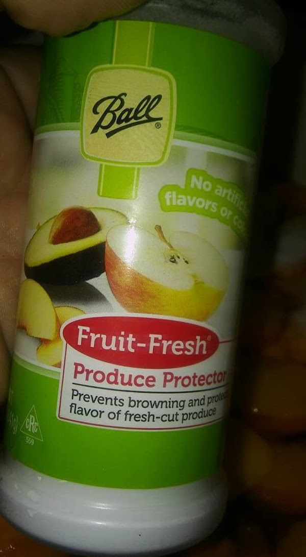 Sprinkle Fruit Fresh over the sliced peaches.  I sprinkle several times and stir...