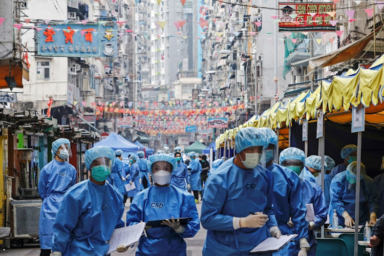 Health workers are seen in protective gear inside a locked down portion of the Jordan residential area to contain a new outbreak of the coronavirus disease in Hong Kong, China on January 23 2021.