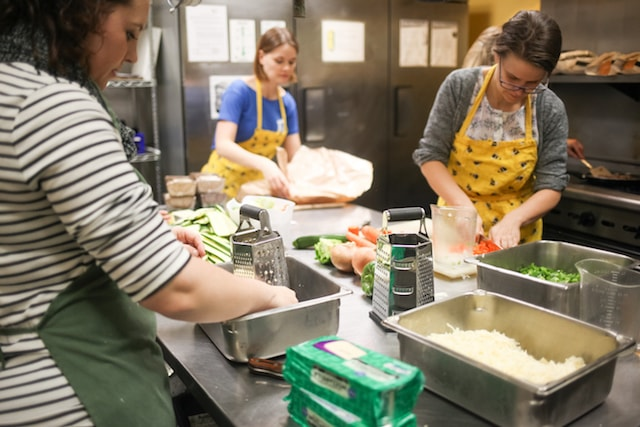 Working in the kitchen at Transitions Project in Portland