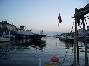 Photo: The swinging bridge opens at Grau du Roi as we pass a British barge we had met in St Gilles