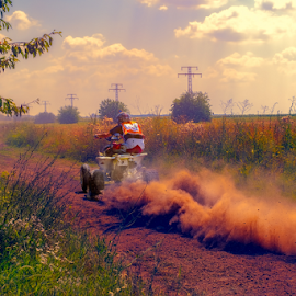 ATV in action by Roberto Sorin - Sports & Fitness Motorsports ( auto, bulgaria, competition, danger, acceleration, road, championship, action, dust, terrain, extreme, rally, drift, motorbike, atv, dirt, adventure, gravel, driver, racer, automotive, drive, mud, gear, motor, motorsport, speed, vehicle, automobile, adrenaline, car, off road, helmet, ivanovo, power, track, tire, dirty, editorial, ruse, motion, race, wheel, technology, transport, rally car, transportation, 4x4, fast, sport,  )