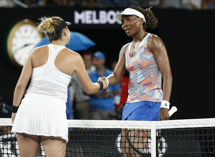 Australian Open - Venus Williams of the U.S. v Belinda Bencic of Switzerland - Rod Laver Arena, Melbourne, Australia, January 15, 2018. Bencic and Williams shake hands after Bencic won their match.