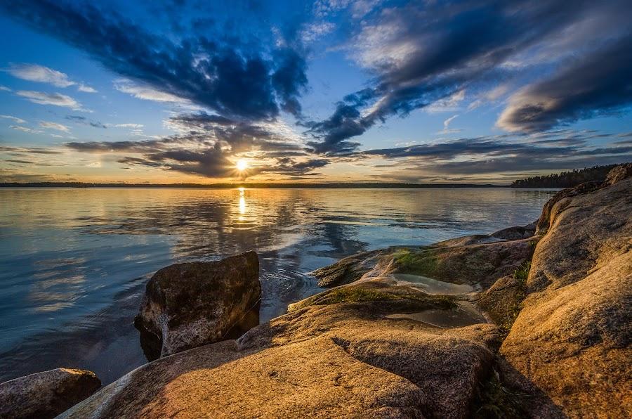 Sunset by Johan Lennartsson - Landscapes Waterscapes ( clouds, sky, warm, sunset, sweden., summer, sea, ocean, morga hage, uppsala, rocks, sun,  )
