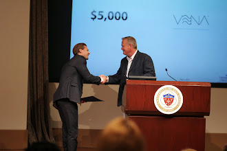 Photo: Mark Bowles presents the Outerwall Award for $5,000 to Vena
