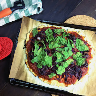 Gluten Free Masa Flatbread w/ Spinach, Caramelized Onions & Red Cabbage.