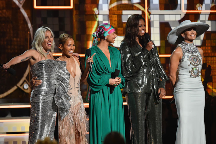 Lady Gaga, Jada Pinkett Smith, Alicia Keys, Michelle Obama, and Jennifer Lopez speak onstage during the 61st annual Grammy Awards.