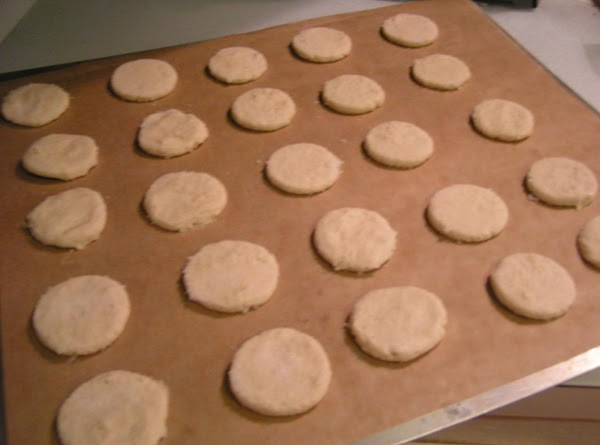 Shape dough into small balls, about 3/4-inch. Place balls 2 inches apart on a...