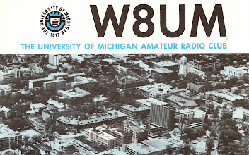 Photo: The club at U of M was in the Michigan Union, with a 2-element quad on the roof of the stairway tower and a TS-830S and SB-220 in the shack. The QSL, however, reports that they had a Collins S3 line and a 100' tower on the East Engineering building (highlighted in the photo). I wonder when they moved and changed gear. This is from 1977-78 but printed earlier.