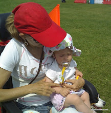 Photo: Nanny and Cassidy.  Scootering around on Canada Day 2010.