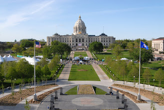 Photo: Minnesotans, dignitaries, and members of the military gather to celebrate during a ceremony held in front of Capitol Building for Minnesota State's Sesquacentennial.