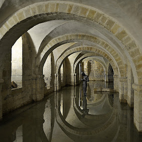 Winchester Cathedral Crypt by Steve Corcoran - Buildings & Architecture Places of Worship ( water, pwcarcreflections, winchester, reflection, uk, statues, churches, anthony gormley, hampshire, gormley, arches, sound ii, cathedral )