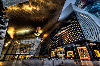 Photo: A Really Pretty Mall  Another photo from the amazingly designed and Crystals Mall which is right next to the Aria where our hotel was. From the outside it really is amazing to think that so much design and engineering went into a Mall! Not that I'm against malls, but well it's just a place to buy non-durable goods (at least it's a hunch that Prada doesn't have any durable goods). This was another one of those handheld set of brackets which the more you do the better you get at. I think the trick is to kneel down very low or sit and just know whatever your camera's threshold is for acceptable noise and shoot for that. In my case 800-1000 is the highest I can go for HDR images on the D7000.  Processing: Nikon D7000   Tokina 11-16mm   Photomatix   Photoshop