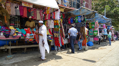 Photo: Clothes are for sale on the street in many areas.