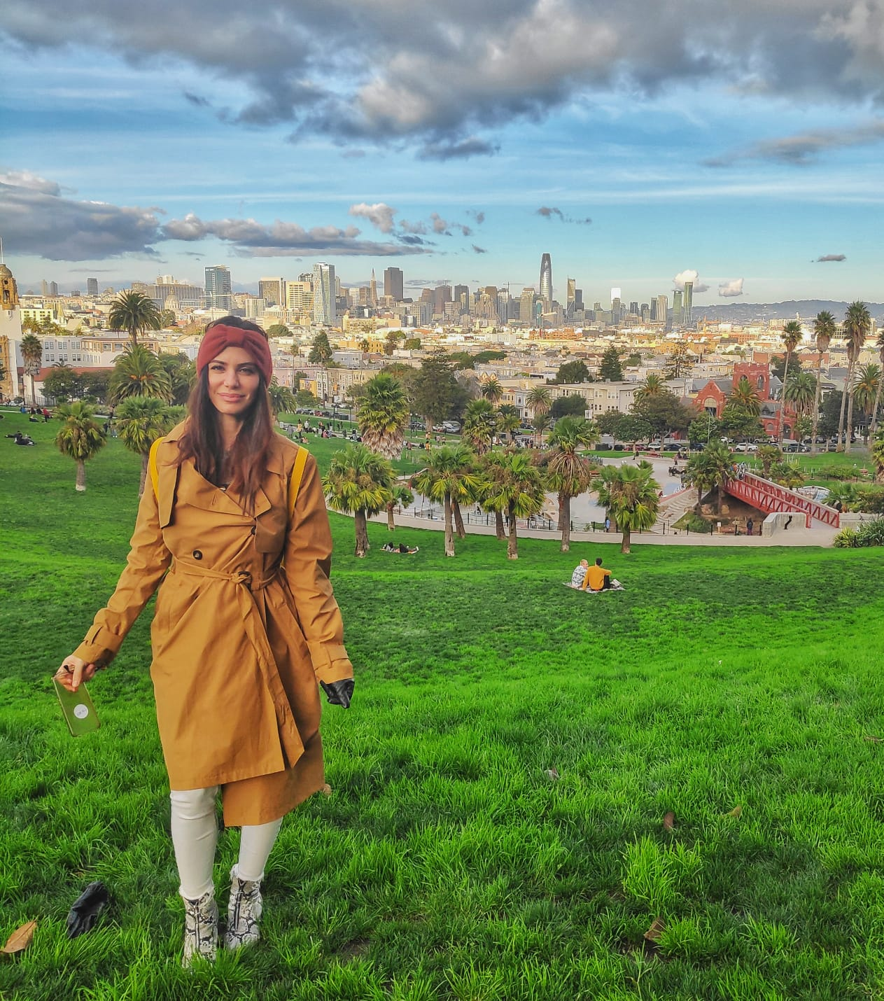 A photo of the author standing on a hill in front of the San Francisco skyline