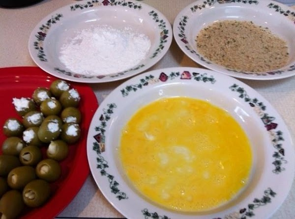 Put flour, egg, breadcrumbs in 3 bowls. Dredge stuffed olives in flour, then egg,...