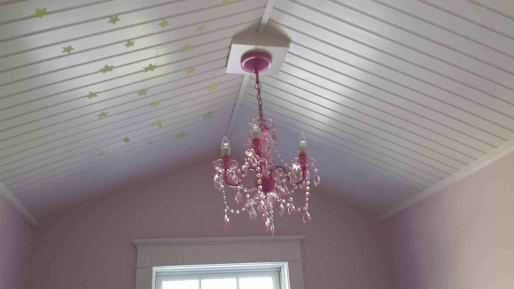 Pink chandelier and glow in the dark lights finish out the dormer!