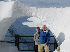 "Photo: ... but are these two 60-somethings capable of such a trek? Time will tell. (A German tourist took this photo of us under a ""snow bridge."")"