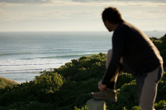 Photo: Dad looking out over a set rolling through tomahawk beach.