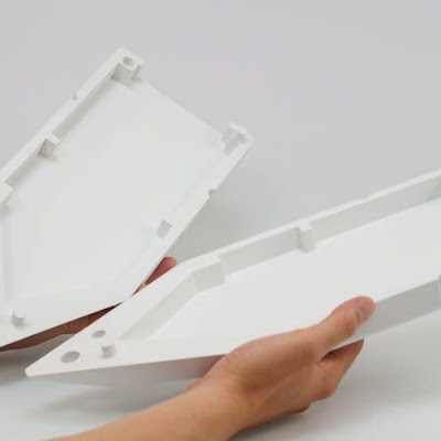 3d printing gallery image of white abs plastic parts which fit together to form an assembly, used as a lawsuit trial model in a copyright case