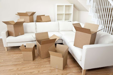 white furniture with moving boxes