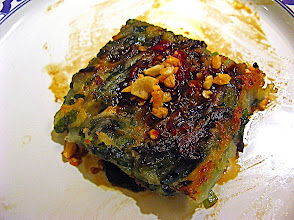 Photo: fried mixed chive cake topped with chilli sauce and fried garlic