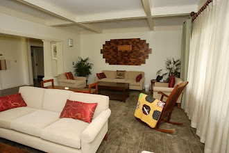Photo: Living Room located upon entrance to Care Center. Koa Plaque donor wall.