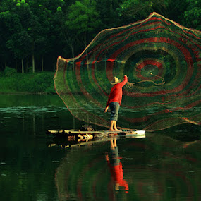 Cast by Ari Yuliarso - People Portraits of Men ( cast, fish, catch, lake, nets )