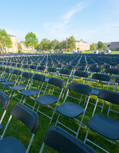 Photo: Work has begun on setting up the thousand of chairs needed for Saturday's Commencement ceremonies. Nearly 15,000 chairs total are set up across campus for the various ceremonies.